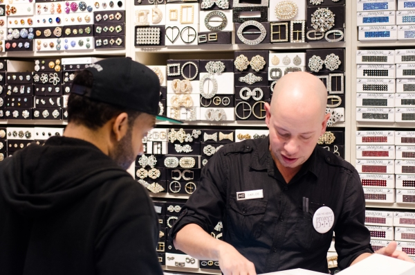 Carlos Helping Guest with Swarovski Rhinestones | M& J Trimming