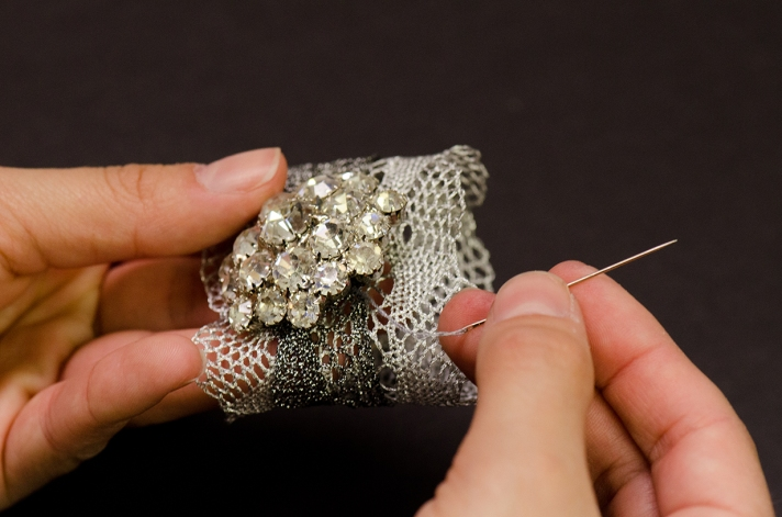 Sewing Rhinestone Button to Metallic Lace | M&J Trimming
